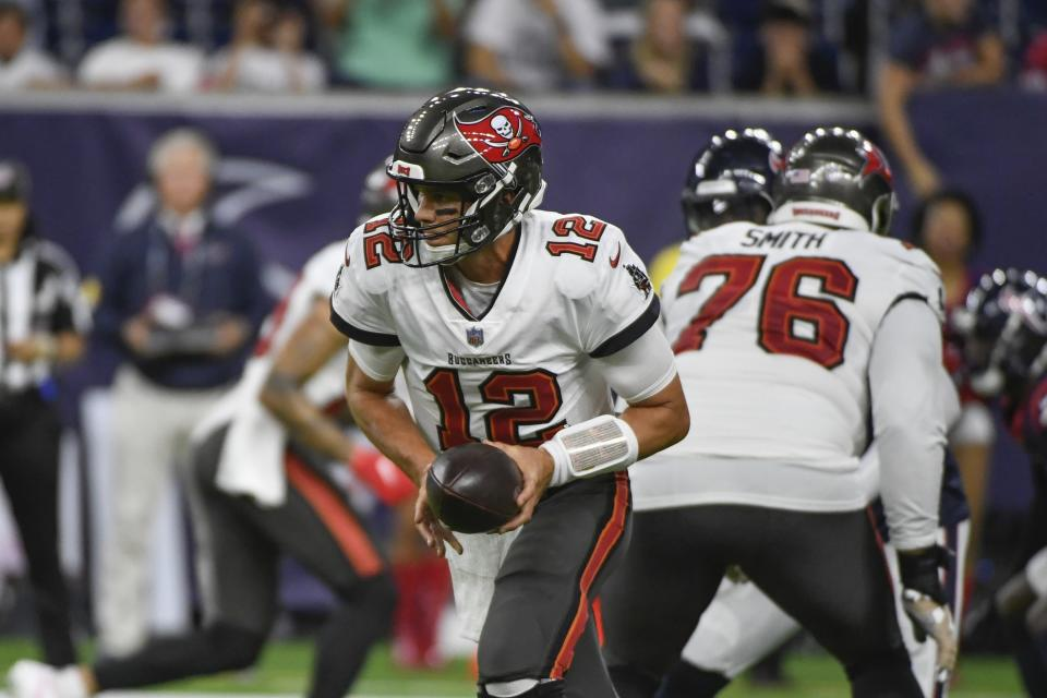 Tampa Bay Buccaneers quarterback Tom Brady (12) hands off the ball against the Houston Texans during the first half of an NFL preseason football game Saturday, Aug. 28, 2021, in Houston. (AP Photo/Justin Rex)