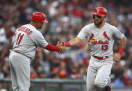 St. Louis Cardinals' Matt Carpenter, right, is congratulated by third base coach Jose Oquendo (11) after hitting a home run off San Francisco Giants' Johnny Cueto during the second inning of a baseball game Thursday, July 5, 2018, in San Francisco. (AP Photo/Ben Margot)