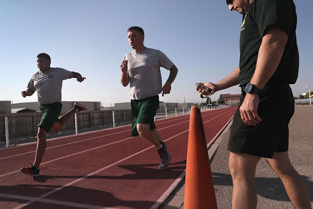 <p>U.S. Border Patrol trainees run during a physical training class at the U.S. Border Patrol Academy on August 3, 2017 in Artesia, N.M. (Photo: John Moore/Getty Images) </p>