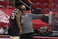 Wake Forest coach Steve Forbes talks with Isaiah Wilkins (23) during the first half of the team's NCAA college basketball game against North Carolina State on Wednesday, Jan. 27, 2021, in Raleigh, N.C. (Ethan Hyman/The News & Observer via AP, Pool)