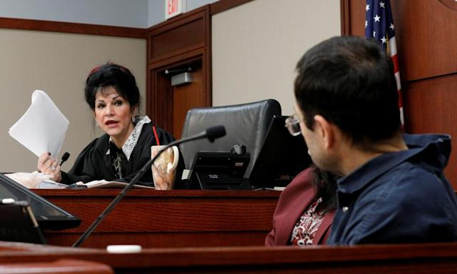 "<span class=""element-image__caption"">Circuit court judge Rosemarie Aquilina addresses Larry Nassar, the former doctor accused of sexually abusing more than 140 girls and women.</span> <span class=""element-image__credit"">Photograph: Brendan Mcdermid/Reuters</span>"