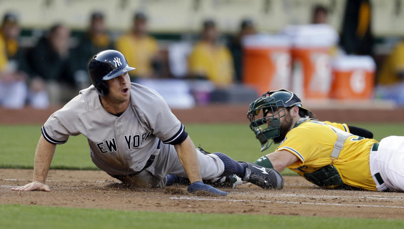 Phelps, Yankees pound A's 7-0 for 4th straight win