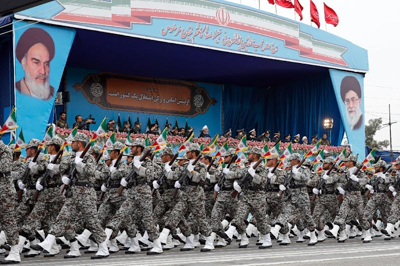 Iranian troops march past dignitaries including President Hassan Rouhani at the annual Army Day parade (AFP Photo/stringer)