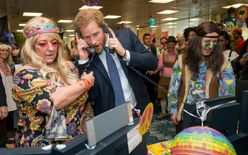 Prince Harry talks on the phone during an ICAP Charity Trading Day - Geoff Pugh