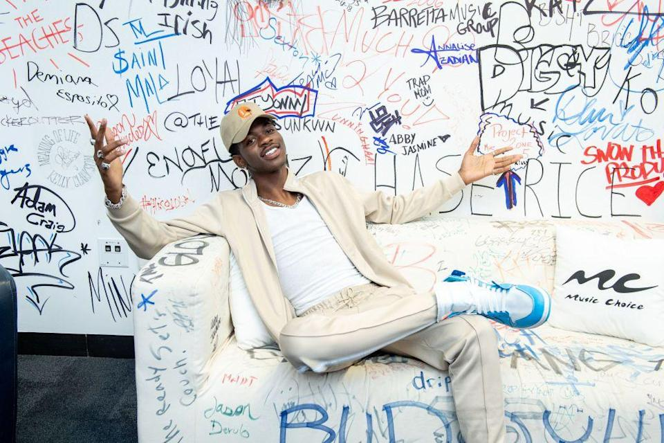 <p>Even chart-toppers have to keep it laid back sometimes! Here, he donned a neutral tracksuit with a white shirt and blue sneakers. </p>