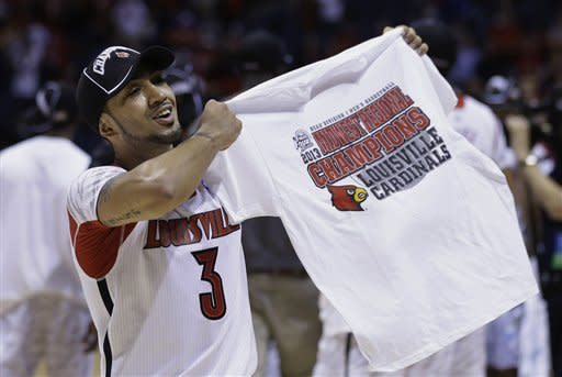 Louisville guard Peyton Siva celebrates following his team's 85-63 win over Duke in Midwest Regional final in the NCAA college basketball tournament, Sunday, March 31, 2013, in Indianapolis. (AP Photo/Darron Cummings)