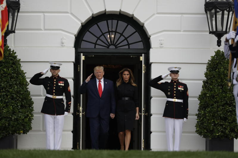 President Donald Trump and first lady Melania Trump walk out to participate in a moment of silence honoring the victims of the Sept. 11 terrorist attacks, on the South Lawn of the White House, Wednesday, Sept. 11, 2019, in Washington. (AP Photo/Evan Vucci)