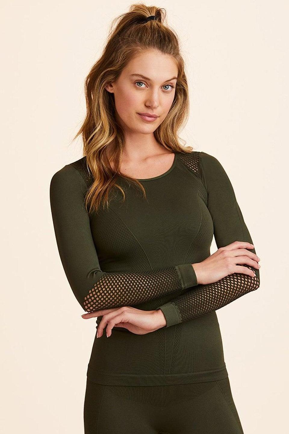 """<p>When asked what style top she recommends, Duckstein explained that she likes tees that complement her waist. """"This [one] is fitted without being too tight,"""" Duckstein said. The signature mesh detailing on the <span>Alala Essential Seamless Long Sleeve Tee</span> ($80) adds breathability, too.</p>"""