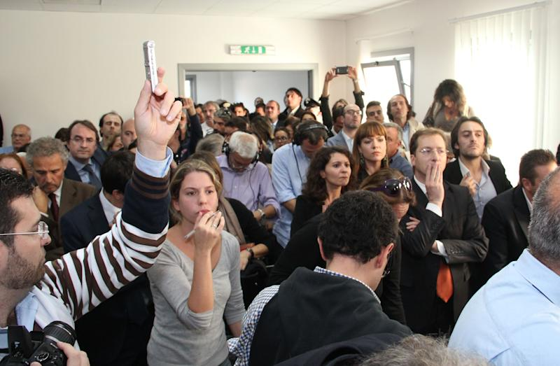 "People listen to the verdict at L'Aquila court, Italy, Monday, Oct. 22, 2012. An Italian court has convicted seven scientists and experts of manslaughter for failing to adequately warn citizens before an earthquake struck central Italy in 2009, killing more than 300 people. The court in L'Aquila Monday evening handed down the convictions and six-year-prison sentences to the defendants, members of a national ""Great Risks Commission."" In Italy, convictions aren't definitive until after at least one level of appeals, so it is unlikely any of the defendants would face jail immediately. Scientists worldwide had decried the trial as ridiculous, contending that science has no way to predict quakes. (AP Photo/Raniero Pizzi)"