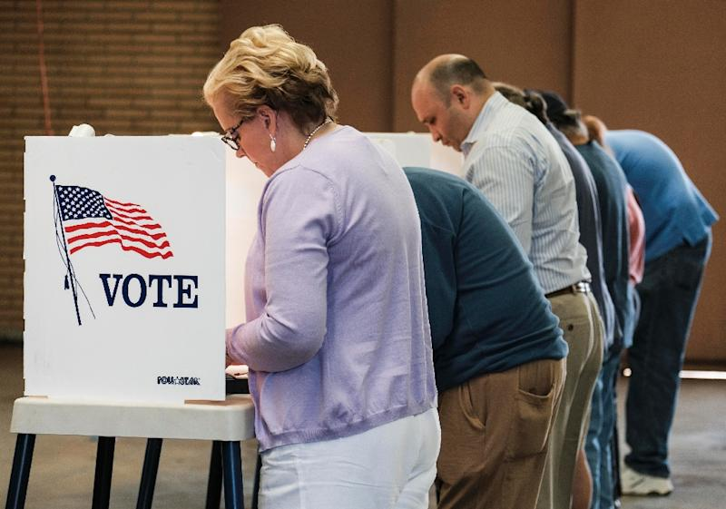 Voters cast their ballots in the US presidential election at a fire station in Alhambra, California, on November 8, 2016