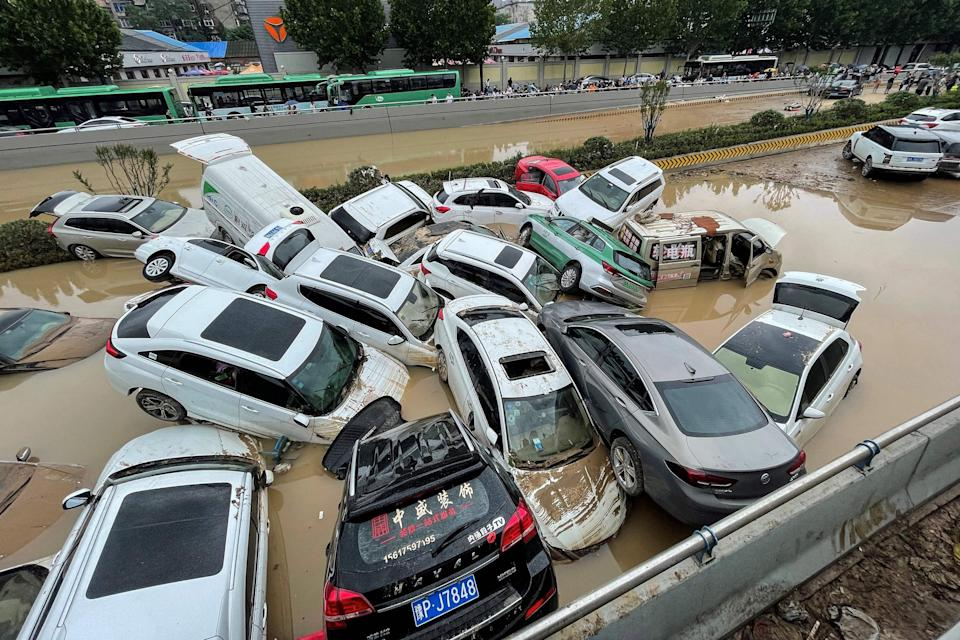 Cars sit in floodwaters after heavy rains hit the city of Zhengzhou in China's central Henan province (AFP/Getty)