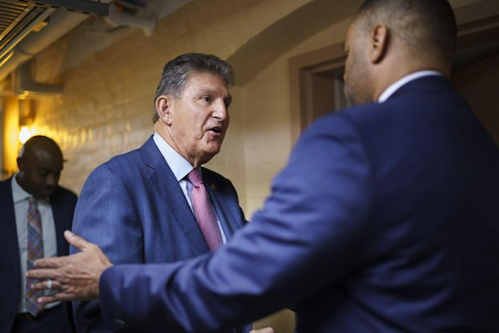 Sen. Joe Manchin, D-W.Va., left, is greeted by Rep. Marc Veasey, D-Fort Worth, at the Capitol in Washington as they arrive to meet with Democratic members of the Texas Legislature on July 15 to discuss voting rights.