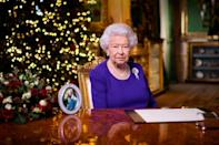 """Britain's Queen Elizabeth II said she was proud of those who have """"risen magnificently to the challenges of the year"""""""