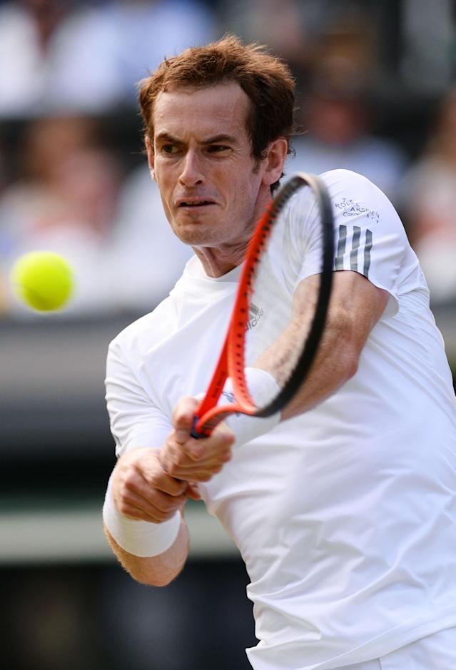 LONDON, ENGLAND - JULY 01: Andy Murray of Great Britain plays a backhand during the Gentlemen's Singles fourth round match against Mikhail Youzhny of Russia on day seven of the Wimbledon Lawn Tennis Championships at the All England Lawn Tennis and Croquet Club on July 1, 2013 in London, England. (Photo by Mike Hewitt/Getty Images)