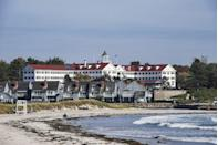 "<p>With this gorgeous, <span class=""redactor-unlink"">historic hotel</span> as your home base, it's impossible not to immediately slip into vacation mode. The impressive white, wooden structure was built in 1914 and has been a family-run business since 1948, drawing summer visitors to Kennebunkport with its hospitality and massive wraparound ocean porch.<br></p><p><strong>EXPLORE NOW</strong>: <a href=""https://www.tripadvisor.com/Hotel_Review-g40694-d225998-Reviews-Colony_Hotel-Kennebunkport_Kennebunks_Maine.html"" rel=""nofollow noopener"" target=""_blank"" data-ylk=""slk:Colony Hotel"" class=""link rapid-noclick-resp"">Colony Hotel</a></p>"