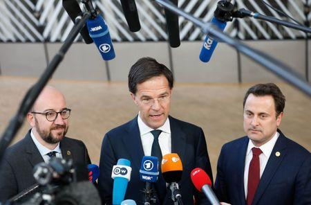 Belgium's Prime Minister Charles Michel, Netherlands Prime Minister Mark Rutte and Luxembourg's Prime Minister Xavier Bettel arrive together at a European Union leaders' summit in Brussels
