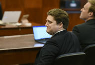 Dewayne Johnson's attorney Brent Wisner reacts as the verdict is read in Johnson's case against Monsanto at the Superior Court of California in San Francisco on Friday, Aug. 10, 2018. A San Francisco jury on Friday ordered agribusiness giant Monsanto to pay $289 million to the former school groundskeeper dying of cancer, saying the company's popular Roundup weed killer contributed to his disease. (Josh Edelson/Pool Photo via AP)