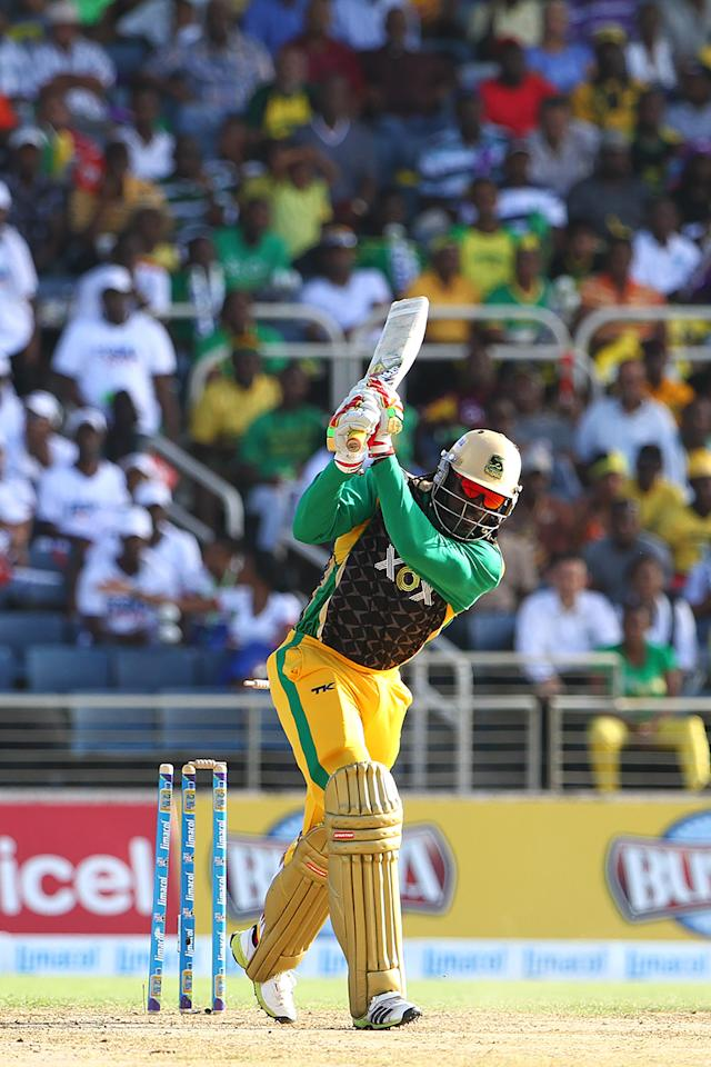 KINGSTON, JAMAICA - AUGUST 15: Jamaica Tallwahs captain Chris Gayle is clean bowled during the Sixteenth Match of the Cricket Caribbean Premier League between Jamaica Tallawahs v Guyana Amazon Warriors at Sabina Park on August 15, 2013 in Kingston, Jamaica. (Photo by Ashley Allen/Getty Images Latin America for CPL)