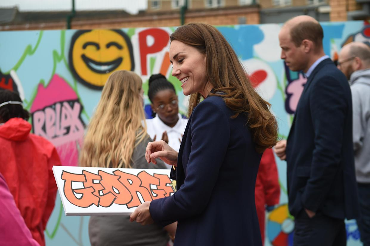The Duchess of Cambridge is presented with a gift for Prince George during a visit to The Way Youth Zone in Wolverhampton, West Midlands. Picture date: Thursday May 13, 2021.