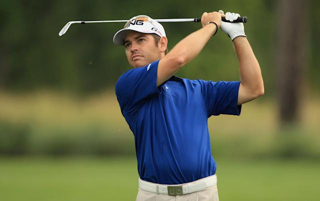 HUMBLE, TX - MARCH 30: Louis Oosthuizen of South Africa watches his approach shot on the second hole during the completion of the weather-delayed first round of the Shell Houston open at Redstone Golf Club on March 30, 2012 in Humble, Texas. (Photo by Scott Halleran/Getty Images)