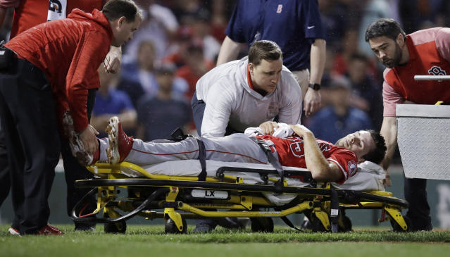 Los Angeles Angels' pitcher Jake Jewell is taken off the field on a stretcher after injuring his right ankle while covering home during the eighth inning against the Boston Red Sox in a baseball game at Fenway Park in Boston, Wednesday, June 27, 2018. (AP Photo/Charles Krupa)