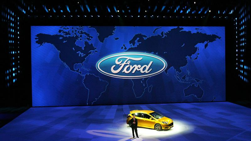 Ford president and CEO Alan Mulally talks to the media in front of the Ford Focus ST during the Ford press conference at Cobo Arena at the 2011 North American International Auto Show held at Cobo Center on Monday, January 10, 2011. ERIC SEALS/Detroit Free Press