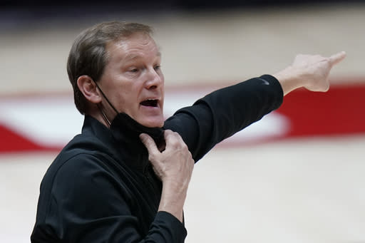 Oregon coach Dana Altman directs the team during the first half of an NCAA college basketball game against Utah on Saturday, Jan. 9, 2021, in Salt Lake City. (AP Photo/Rick Bowmer)
