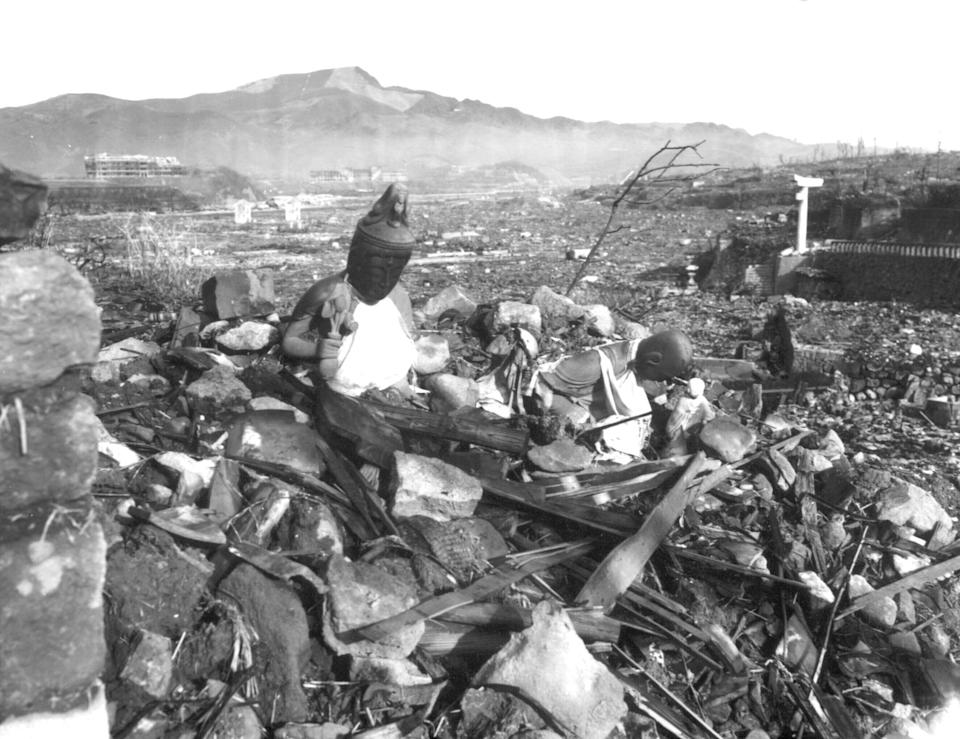FILE - In this Sept. 24, 1945, file photo, released by U.S. Marines, a battered religious figure stands witness on a hill above a burn-razed valley at Nagasaki, Japan, after the second atomic bomb ever used in warfare was dropped by the U.S. over the Japanese industrial center. The city of Nagasaki in southern Japan marks the 75th anniversary of the U.S. atomic bombing of Aug. 9, 1945. (U.S Marines via AP, File)