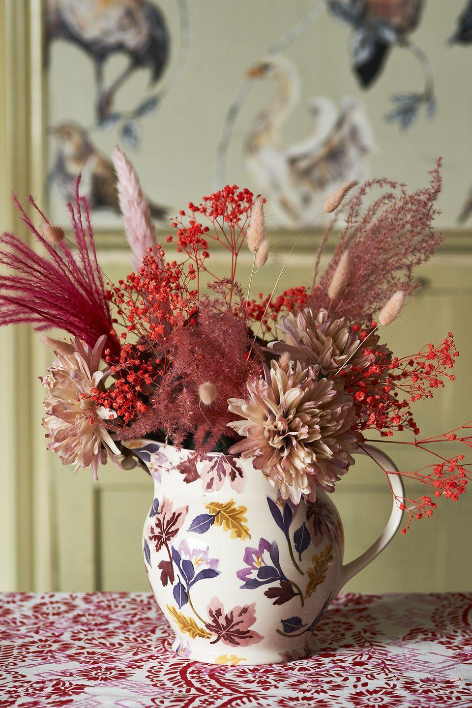 """<p>Show off your favourite autumnal <a href=""""https://www.housebeautiful.com/uk/garden/plants/a36874506/grow-your-own-wedding-flowers/"""" rel=""""nofollow noopener"""" target=""""_blank"""" data-ylk=""""slk:blooms"""" class=""""link rapid-noclick-resp"""">blooms</a> with this pretty jug from the Crocus range. Adorned with hues of rustic red, dark purple and mustard yellow, it's just what every kitchen table needs this autumn.</p><p><a class=""""link rapid-noclick-resp"""" href=""""https://go.redirectingat.com?id=127X1599956&url=https%3A%2F%2Fwww.emmabridgewater.co.uk%2Fproducts%2Fautumn-crocus-1-1-2-pint-jug&sref=https%3A%2F%2Fwww.housebeautiful.com%2Fuk%2Flifestyle%2Fshopping%2Fg37527696%2Femma-bridgewater-autumn-range%2F"""" rel=""""nofollow noopener"""" target=""""_blank"""" data-ylk=""""slk:BUY NOW, £34.95"""">BUY NOW, £34.95</a></p>"""