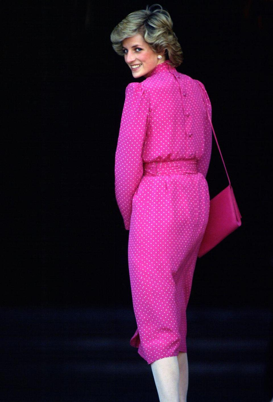 <p>Be still our hearts over this hot pink polka dot knee-length look, complete with matching bag. </p>