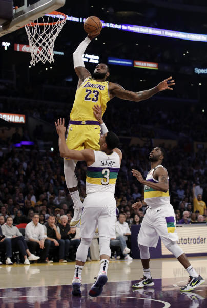 Los Angeles Lakers forward LeBron James (23) dunks over New Orleans Pelicans' Josh Hart (3) during the first half of an NBA basketball game Tuesday, Feb. 25, 2020, in Los Angeles. (AP Photo/Marcio Jose Sanchez)