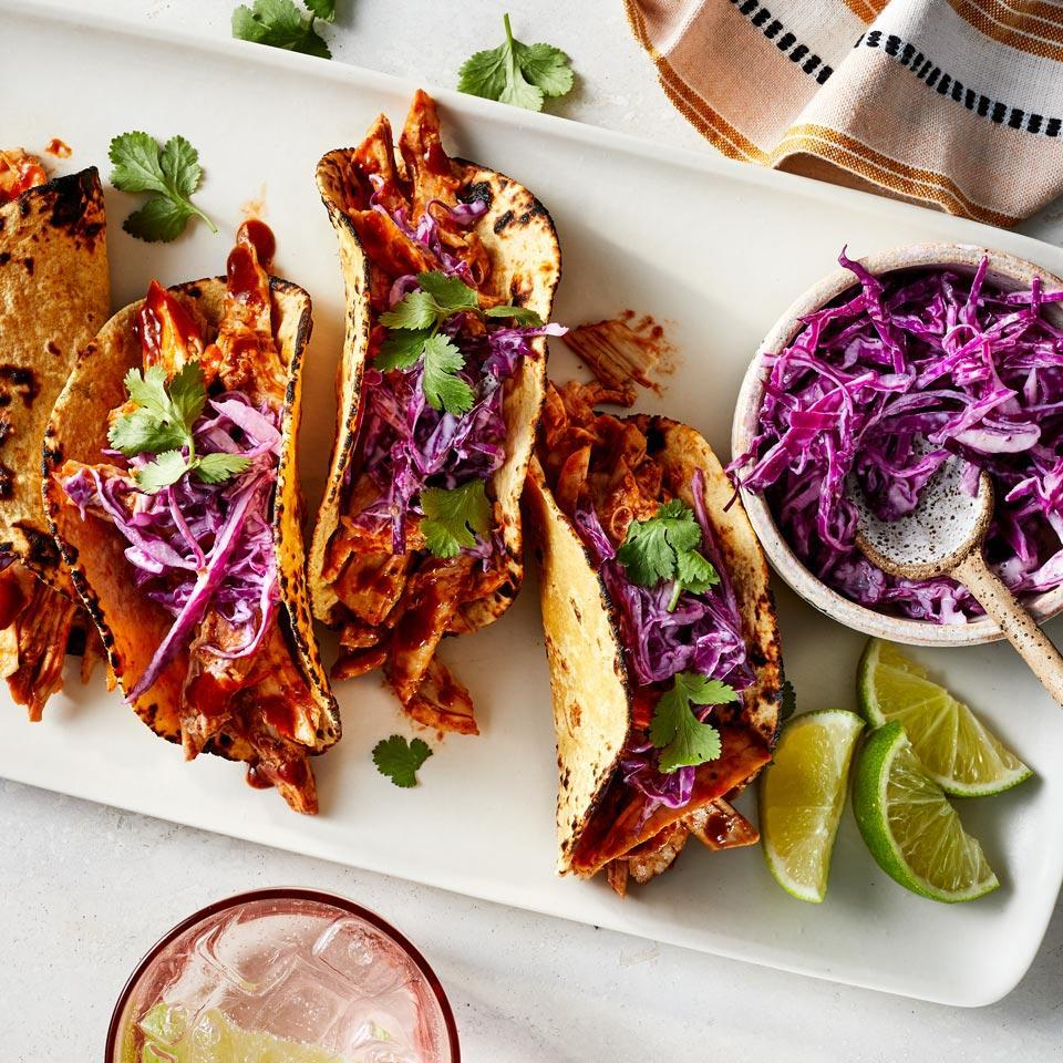 <p>This zippy, creamy slaw is so good you might find yourself making it for other sandwiches. Still, it pairs beautifully with the tangy pulled chicken for an incredibly quick dinner you can make even on your busiest nights. To save even more time, use a preshredded coleslaw blend.</p>