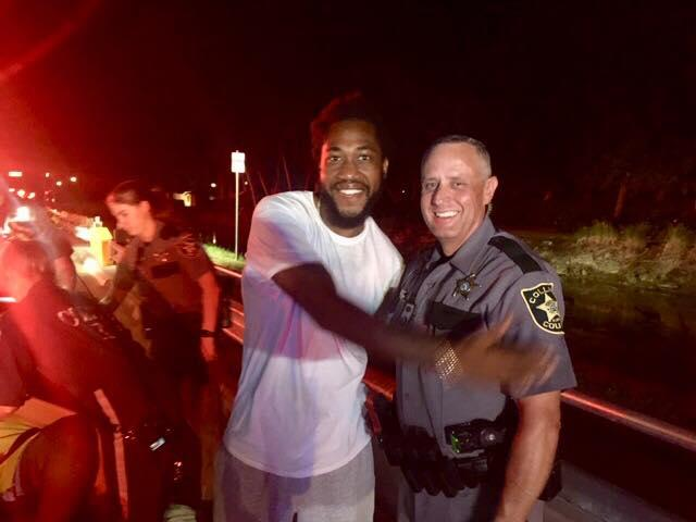 Jean-Louis Wilfried, Right, and CCSO Deputy Robert Pounds. Courtesy of Collier County Sheriff's Office.