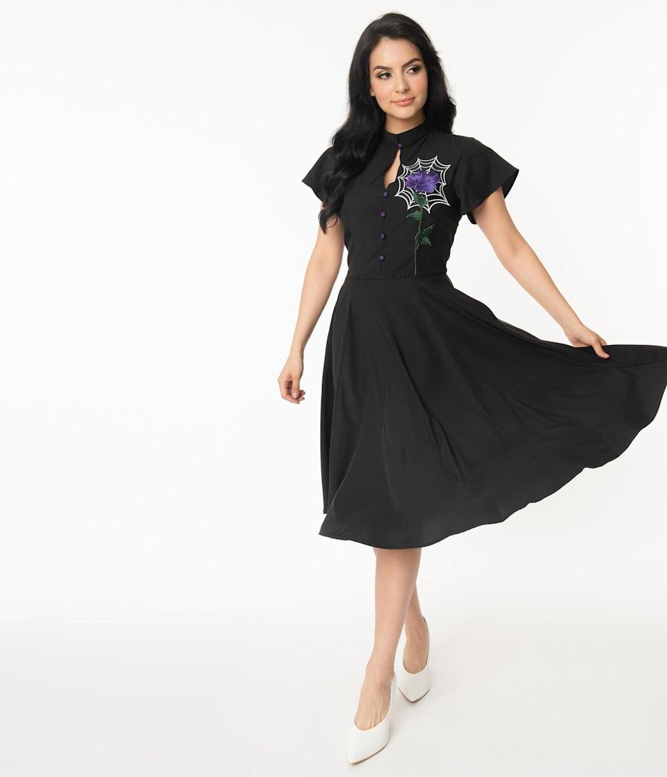 <p>The <span>Unique Vintage Black Spiderweb and Purple Rose Baltimore Swing Dress</span> ($98) is bone-chilling, in the best way. </p>
