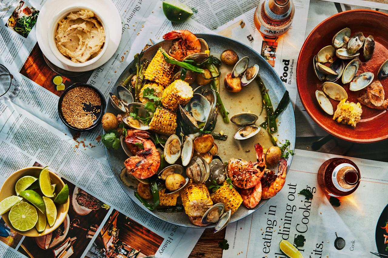 """All the best components of a classic summer clambake—potatoes, shrimp, corn on the cob—get an extra layer of flavor when grilled and brushed with gingery miso butter in this festive, large-format feast. <a href=""""https://www.epicurious.com/recipes/food/views/grilled-clambake-with-miso-lime-butter?mbid=synd_yahoo_rss"""">See recipe.</a>"""