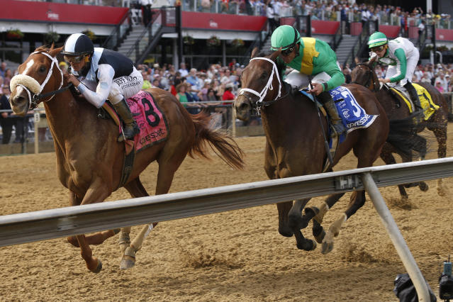 Point of Honor with Javier Castellano aboard wins the Black Eyed Susan horse race at Pimlico Race Course, Friday, May 17, 2019, in Baltimore. Ulele with Joel Rosario atop finishes second with Cookie Dough with Irad Ortiz Jr. onboard places third.(AP Photo/Lauren Helber)