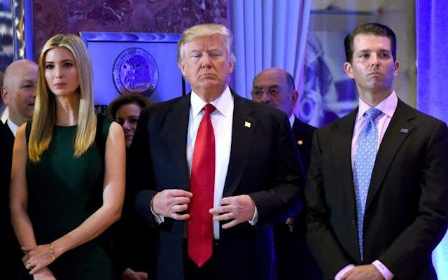 President-elect Donald Trump stands with his children Ivanka and Donald Jr., during Trump's press conference at Trump Tower in New York on Jan. 11, 2017. (Photo: Timothy A. Clary/AFP/Getty Images)