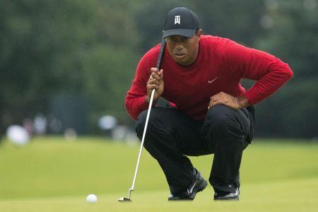 FILE PHOTO: Sep 10, 2018; Newtown Square, PA, USA; Tiger Woods lines up a putt on the 13th hole during the final round of the BMW Championship golf tournament at Aronimink GC. Mandatory Credit: Bill Streicher-USA TODAY Sports