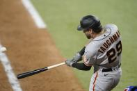 San Francisco Giants' Mike Tauchman hits a grand slam off Texas Rangers relief pitcher Josh Sborz during the eighth inning of a baseball game in Arlington, Texas, Tuesday, June 8, 2021. (AP Photo/Tony Gutierrez)