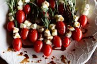 """<p>This festive appetizer is both easy and elegant. Use fresh rosemary twigs in place of skewers to hold the tomatoes and mozzarella. </p><p><a href=""""https://www.thepioneerwoman.com/food-cooking/recipes/a78788/rosemary-caprese-skewers/"""" rel=""""nofollow noopener"""" target=""""_blank"""" data-ylk=""""slk:Get Ree's recipe."""" class=""""link rapid-noclick-resp""""><strong>Get Ree's recipe.</strong></a></p><p><a class=""""link rapid-noclick-resp"""" href=""""https://go.redirectingat.com?id=74968X1596630&url=https%3A%2F%2Fwww.walmart.com%2Fsearch%3Fq%3Dpioneer%2Bwoman%2Bcocktail%2Bnapkins&sref=https%3A%2F%2Fwww.thepioneerwoman.com%2Ffood-cooking%2Fmeals-menus%2Fg37320750%2Fthanksgiving-appetizers%2F"""" rel=""""nofollow noopener"""" target=""""_blank"""" data-ylk=""""slk:SHOP COCKTAIL NAPKINS"""">SHOP COCKTAIL NAPKINS</a></p>"""