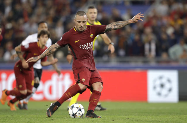 Roma's Radja Nainggolan scores his side's fourth goal during the Champions League semifinal second leg soccer match between Roma and Liverpool at the Olympic Stadium in Rome, Wednesday, May 2, 2018. (AP Photo/Andrew Medichini)