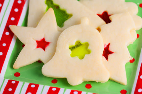 """<div class=""""caption-credit""""> Photo by: Jaime</div><div class=""""caption-title""""></div><b>Stained Glass Cookies</b> <br> <b><i>Ingredients:</i></b> <br> 2 sticks (1 cup) unsalted butter, 1 cup granulated sugar, 1 large egg, 1 teaspoon pure vanilla extract, 1/2 teaspoon almond extract, 1 teaspoon kosher salt, 3 cups flour, 3/4 teaspoon baking powder, several Jolly Rancher candies, cut into 1/4″ pieces <br> <b><i>Directions:</i></b> <br> 1. Beat butter and sugar until light and fluffy. Add in egg and beat until well incorporated. Add vanilla and almond extract. Beat until smooth. With mixer on low, add in salt, flour, and baking powder, and mix until dough is uniform. Wrap in plastic wrap. Refrigerate for 25 minutes. <br> 2. Preheat oven to 350. On a floured surface, roll dough to 1/8 inch thick. Cut into shapes and place on a parchment paper lined cookie sheet. Use a smaller cookie cutter to cut a shape in the center of the cookie. Bake for 4 minutes. Remove from oven, and fill cutout shapes with candy pieces. Bake for 4 minutes. Let cookies cool completely on the cooki"""