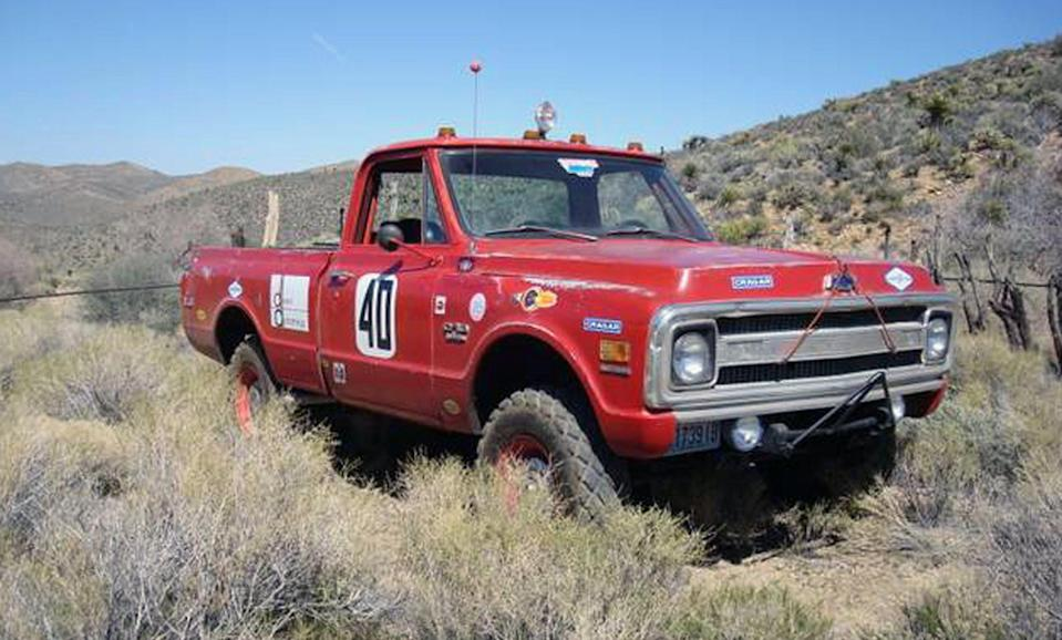 """This photo provided by Courtesy of Mecum Auctions, a 1969 Chevrolet C/10 Baja race truck once owned by actor Steve McQueen is shown. McQueen's old truck and prescription sunglasses worn by John Lennon are among hundreds of items once owned by celebrities that are scheduled to be auctioned in California next month. The Mecum Auction Company said Wednesday, June 26, 2013, it will be displaying and auctioning about 2,000 pieces of celebrity-related memorabilia in Santa Monica, Calif. on July 26-27. Mecum, which specializes in the sale of collector cars, says one of the auction's highlights will be Elvis' 1972 Cadillac Custom Estate Wagon. """"The King of Rock n' Roll"""" owned the car from 1972 until his death in 1977, according to Mecum's Web site. (AP Photo/Courtesy of Mecum Auctions, David Newhardt)"""