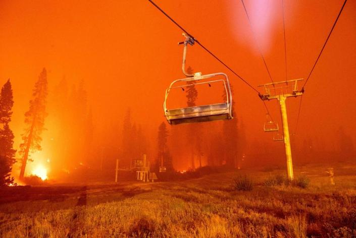 Flames from the Caldor fire surround a chair lift at Sierra-at-Tahoe ski resort on 29 August.