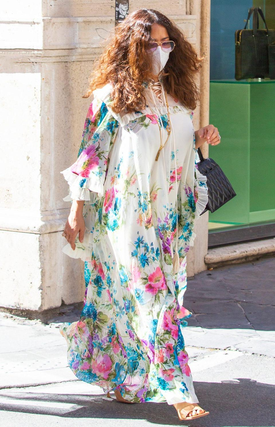 <p>Salma Hayek strolls through Rome in a flowy floral-print gown on Friday.</p>