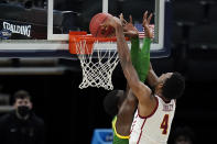 Southern California forward Evan Mobley (4) dunks the ball over Oregon center Franck Kepnang, left, during the second half of a Sweet 16 game in the NCAA men's college basketball tournament at Bankers Life Fieldhouse, Sunday, March 28, 2021, in Indianapolis. (AP Photo/Jeff Roberson)