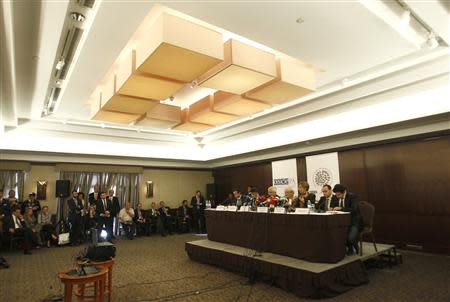 Monitors from OSCE attend a news conference in Baku