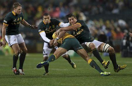 Eben Etzebeth (R) and Bryan Habana (2nd L) of South Africa's Springboks tackle Israel Folau (2nd R) of Australia's Wallabies during their Tri-Nations rugby union match at Subiaco Oval in Perth, Western Australia, September 6, 2014.