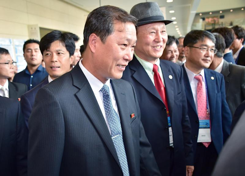 Yang Song-Ho (C), the dean of the Korean University of Physical Education in Pyongyang, arrives to attend an international conference on sport's role in improving relations among Asians in Incheon on August 20, 2014