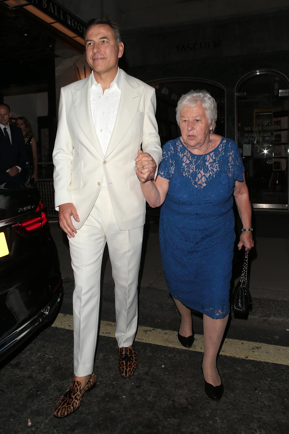 David Walliams wears a white suit to celebrate his 50th birthday party at Claridge's hotel with mum Kathleen Williams in Mayfair on September 04, 2021 in London, England. (Photo by Ricky Vigil/GC Images)